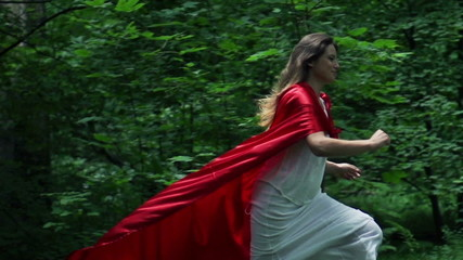 Woman in red cape run in forest, super slow motion, 240fps