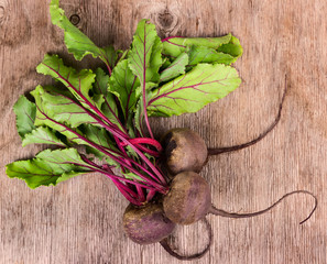 Fresh beet on wooden background background.