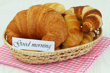 Good morning card with butter croissants in bread basket