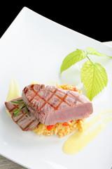 Fine dining / Medium rare sashimi tuna steak on saffron risotto