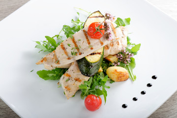 Grilled chicken fillet with fresh vegetables and potato