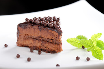Fine dining, close up of a chocolate cream cake on white plate