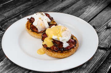 Benedict eggs with crispy bacon and hollandaise sauce
