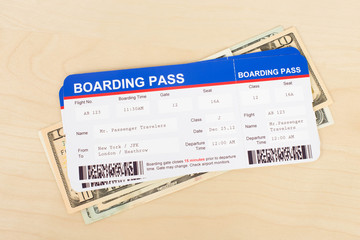 Boarding pass and dollar banknote concept for travel expenses