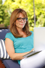 Modern mature woman portrait with laptop