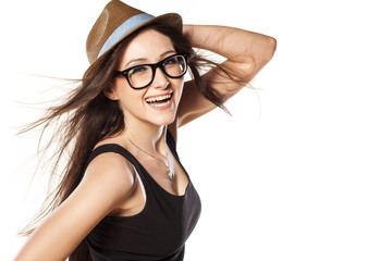 excited and happy woman with hat on white background