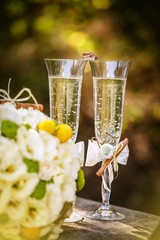 Wedding rings with roses and glasses of champagne