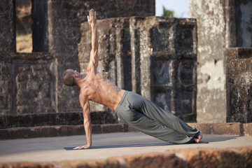 Beautiful yoga position at the ruins of India.