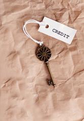 Vintage key with word credit