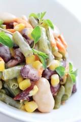 mixed bean salad in white bowl