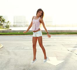 girl jumping over sunst