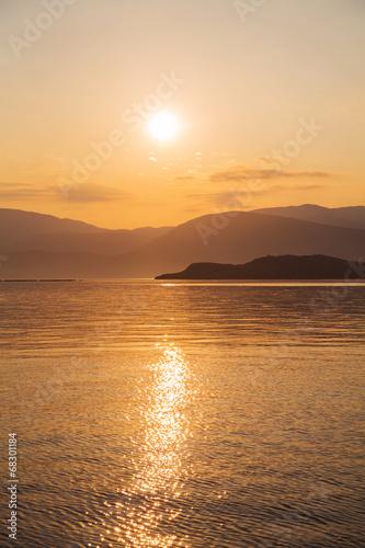 canvas print picture Sonnenaufgang am Meer als Hintergrund
