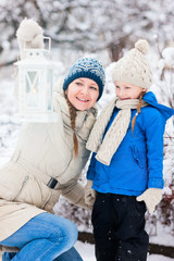 Mother and daughter with Christmas lantern