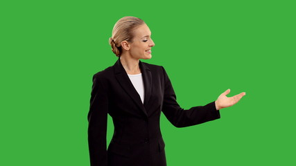 businesswoman presenting and shows thumb on green screen.