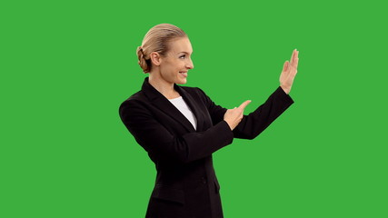 businesswoman presenting and shows thumb on green screen. +alpha
