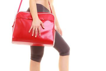 Sport. Red gym bag of fitness sporty girl in sportswear