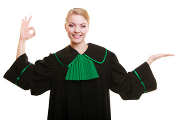 Law. Woman lawyer in polish gown showing ok blank