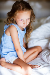 Sweet little girl in light blue pajama