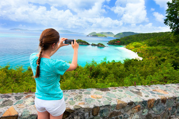 Tourist girl at Trunk bay on St John island
