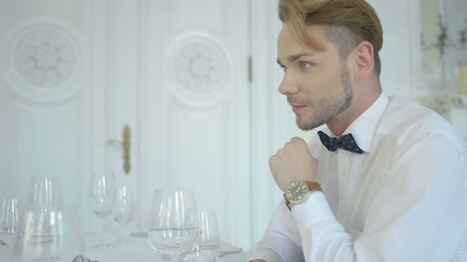 Handsome man in luxury restaurant interior during a date