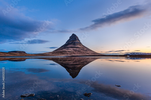 Kirkjufell and reflection in beautiful sunrise, Iceland
