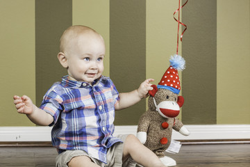 Happy Toddler Boy and Sock Monkey