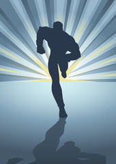 Silhouette of a male figure running in front of light burst