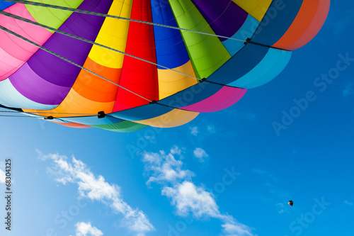 Foto op Aluminium Luchtsport Colorful Hot Air Balloon Flying in the Blue Sky