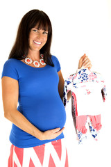 happy expectant mother holding new girl baby clothes