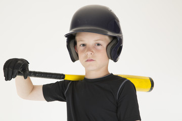 Young boy baseball player resting bat on his shoulder intense fa