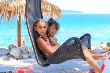 Girls on the beach shade