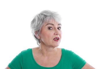 Generation 50 plus: Gesicht ältere Frau isoliert in Grün