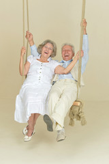 Elderly couple on swing