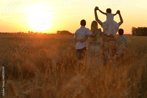 canvas print picture Family walking in field