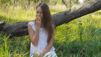 Girl eats a peach
