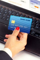 Businesswoman holding credit card - e banking / shopping