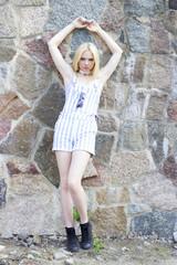 girl at rock wall