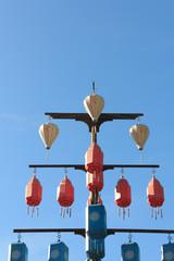 Lamp on a pole with blue sky.