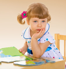 Girl sitting at the table.