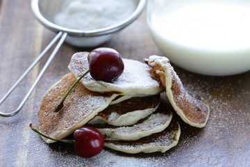 sweet dessert pancakes with powdered sugar for breakfast