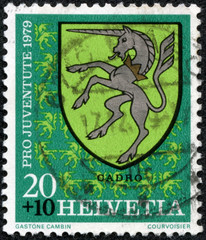 stamp printed by Switzerland, shows Cadro Arms