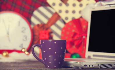 Cup of coffee on christmas background.