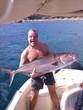 pescatore con ricciola