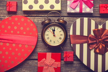 Retro alarm clock and christmas gifts around