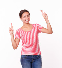 Cute female with luck fingers standing
