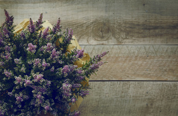heather flowers over rustic wooden background.