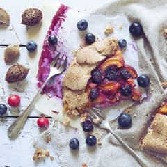 polaroid of wholemeal french galette with fruits sliced