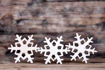 Three Snowflakes on Wood III