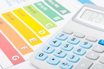 Energy efficiency chart with calculator over it - studio shot