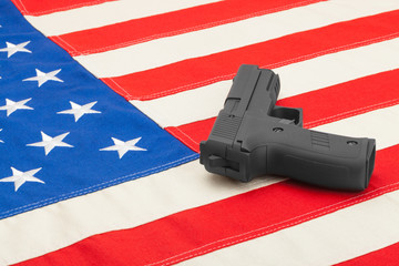 Gun laying over USA flag - studio shoot